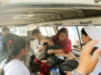 acid-victim-inside-the-ambulance-with-teacher-and-classmates