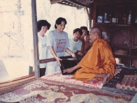 2-giving-radio-to-a-monk-in-prey-kabbas-cambodia-1993
