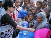 giving-money-and-blanket-to-an-old-lady-affected-ny-cyclone-sidr