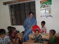 giving-school-bag-to-a-child-learner-at-cews-school-for-slum-children-in-dhaka-2