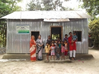infront-of-newly-built-school-koltapara-teacher-advisor-ed-with-children