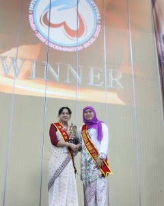 Receiving award as Filmmaker of Inspiration from the Minister for Social Affairs, Indonesia on the occasion of International Women's Day 2016