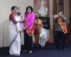 Receiving award from the Dirctor General, Radio Republik Indonesia